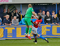 Football - 2021 / 2022 Emirates FA Cup - First Round Qualifying - Bootle vs. FC United of Manchester - Berry Street Garage Stadium - Saturday 4th September 2021<br /> <br /> Cedric Main of FC United of Manchester heads the ball past keeper Ryan Jones of Bootle to put his side 1-0 ahead, at the Berry Street Garage Stadium.<br /> <br /> COLORSPORT/Alan Martin