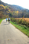 Spouses age 55 bicycling on the Root River State Trail.  Lanesboro  Minnesota USA