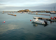Boats in the harbour and Castle Cornet, St Peter Port, Guernsey, Channel Islands, UK