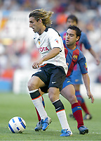 Miguel Angel ANGULO, Spanish Football player and Valencia forward, in action with his fellow countryman XAVI Hernandez, Barcelona midfielder. Valencia - Barcelona / League 2004-05. Mestalla Stadium, Valencia. 08-05-2005.<br />  <br /> Norway only