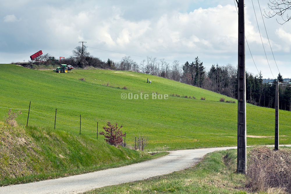rural landscape with container and tractor during spring sowing France Languedoc Aude