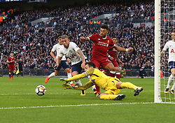 22 October 2017 Wembley: Premier League Football: Tottenham Hotspur v Liverpool: Tottenham goalkeeper Hugo Lloris dives to save the ball before Alex Oxlade-Chamberlain of Liverpool can intercept.<br /> Photo: Mark Leech