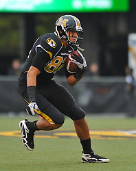Nov 13, 2010; Columbia, MO, USA; Missouri Tigers tight end Michael Egnew (82) catches a pass and runs for yardage in the first half against the Kansas State Wildcats at Memorial Stadium. Missouri won 38-28.  Mandatory Credit: Denny Medley-US PRESSWIRE