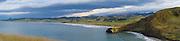 High-angle panoramic view looking over Katiki Beach from Katiki Point, Otago, New Zealand