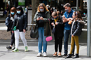 A family is seen waiting at the traffic lights during the COVID-19 in Melbourne. With over a week of zero cases in Victoria, Premier Daniel Andrews is expected to make major announcements on Sunday about further easing of restrictions. (Photo by Dave Hewison/Speed Media)