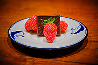 Indoor hydroponic Strawberries and Chocolate. Composite of 50 focus stacked images taken with a Fuji X-T3 camera and 80 mm f/2.8 macro lens (ISO 160, 80 mm, f/2.8. 1/15 sec). Raw images processed with Capture One Pro and Focus Magic.