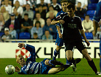 Photo: Daniel Hambury.<br /> Reading v Swansea. Carling Cup.<br /> 23/08/2005.<br /> Reading's and Swansea's Roberto Martinez battle for the ball.