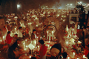 Day of the Dead festival honoring ancestors in a graveyard vigil in Mixquic, Mexico, outside Mexico City.
