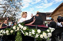 16.04.2011, Going am Wilden Kaiser, Tirol, AUT, kirchliche Trauung von Maria Riesch und Markus Höfl in der Pfarrkirche zum Hl. Kreuz, im Bild die Skirennfahrerin Maria Höfl-Riesch und ihr Ehemann Marcus Höfl in der Hochzeitskutsche // the german skieracer Maria Riesch-Hoefl and her husband Marcus Hoefl during church wedding at Church of the Holy Cross in Going, Austria on 16/4/2011. EXPA Pictures © 2011, PhotoCredit: EXPA/ J. Groder / SPORTIDA PHOTO AGENCY