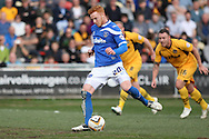 Ryan Taylor of Portsmouth scores his side's first goal from the penalty spot. Skybet football league two match, Newport county v Portsmouth at Rodney Parade in Newport, South Wales on Saturday 29th March 2014.<br /> pic by Mark Hawkins, Andrew Orchard sports photography.