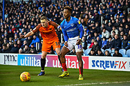Portsmouth Midfielder, Jamal Lowe (10) beats Southend United Midfielder, Sam Mantom (18) to the ball during the EFL Sky Bet League 1 match between Portsmouth and Southend United at Fratton Park, Portsmouth, England on 8 December 2018.