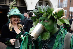LNP Weekly Highlights 02/05/14. FILE PICTURE. © Licensed to London News Pictures. 01/05/2014. Greeenwich, London. Deptford Jack in the green. The Jack in the Green tradition developed from the 17th Century custom of milkmaids going out on May Day with the utensils of their trade - silver cups, pots, spoons - decorated with garlands and piled into a pyramid which they carried on their heads. By the mid eighteenth century other groups, notably chimney sweeps, were moving in on the milkmaids' territory as they saw May Day as a good opportunity to collect money.. Photo credit : Mike King/LNP
