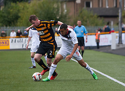 Alloa Athletic's Michael Doyle and Falkirk's Phil Roberts.<br /> Alloa Athletic 0 v 0 Falkirk, Scottish Championship 12/10/2013. played at Recreation Park, Alloa.<br /> ©Michael Schofield.