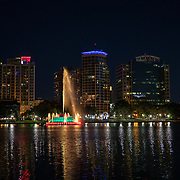 Downtown Orlando and the Lake Eola fountain are seen on Sunday, May 3, 2020 in Orlando, Florida. Governor Ron DeSantis will being opening parts of the state back up from the Coronavirus outbreak in phases, with phase one beginning on Monday, May 4. (Alex Menendez via AP)