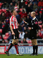 Photo: Andrew Unwin.<br />Sunderland v Wigan Athletic. The Barclays Premiership. 11/03/2006.<br />Sunderland's Kevin Kyle (L) is booked for dissent by the referee, Mike Riley (R).