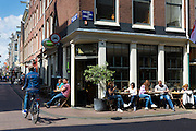 People drinking at bar in Egelantierstraacht in the trendy Jordaan district of  Amsterdam, Holland