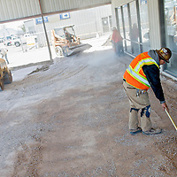 050213       Cable Hoover<br /> <br /> A construction crew from Murphy Builders prep the ground for new concrete at Amigo Chevrolet in Gallup Thursday.