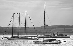 """The recently refitted paddle steamer Waverley passes the bunting of Adix a 220' Schooner  and Moonbeam anchored off Largs at the end of the regatta.<br /> Limited to ten prints in Black & White, printed on fine art paper 24""""x16"""", stamped and signed."""