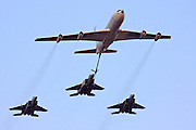 3 Israeli Air force F15 Fighter jets being refueled by a Boeing 707 in flight.