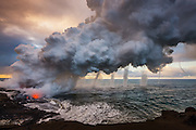 """WINNER<br /> 2012 Power of Nature<br /> Windland Smith Rice International Awards<br /> """"On an early morning shoot at the Waikupanaha ocean entry, lava from Kilauea volcano poured into the sea, creating a huge steam plume that rose with such velocity, it generated multiple vortices as it billowed upward into the sky. A vortex or two is a rare sight... but when one after another kept forming, my fumbling with the lenses turned into a panicked rush to switch to my wide angle to be able to capture this incredible scene of seven vortices in a row!"""""""