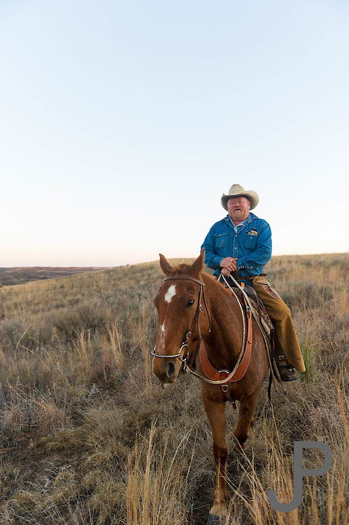 Odell Mayfield rides his horse at the Packsaddle Wildlife Management Area south of Arnett, Oklahoma.