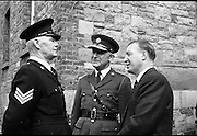 Garda Passing Out Parade and presentation of Scott Medals.  The Minister for Justice Mr. Charlie Haughey T.D. and Chief Super. D.J. Costigan chatting to Sergeant James Doddy after he recieved a Scott Gold Medal for couragous action..04.05.1962