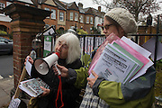 Writer Hylda Sims reads her aloud poetry during a reading outside Carnegie Library in Herne Hill, south London asking passing motorists to hoot their support, while occupiers remain inside the premises on day 8 of its occupation, 7th April 2016. The angry local community in the south London borough have occupied their important resource for learning and social hub for the weekend. After a long campaign by locals, Lambeth have gone ahead and closed the library's doors for the last time because they say, cuts to their budget mean millions must be saved.