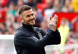 Manchester United Legends David Beckham warms up before the legends match at Old Trafford, Manchester.