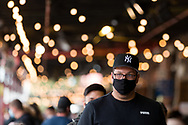 A man wearing a mask is seen towering above a packed South Melbourne Market during COVID-19 in Melbourne, Australia. Melbourne held hostage to a Premier unwilling to open up. After promising businesses and Melbournians that 'significant' announcements over easing restrictions would be made today, Premier Daniel Andrews once again backtracked on his commitments and has delayed Melbourne's reopening. This comes as the Northern Metro cluster continues to grow. (Photo by Dave Hewison/Speed Media)