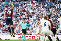 Real Madrid's player Cristiano Ronaldo and Nacho Fernandez and Eibar FC's player Florian Lejeune during a match of La Liga Santander at Santiago Bernabeu Stadium in Madrid. October 02, Spain. 2016. (ALTERPHOTOS/BorjaB.Hojas)