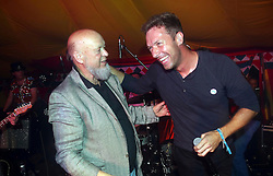 © London News Pictures. 18/10/2015. Chris Martin lead singer of Coldplay sings Karaoke at Michael Eavis's 80th birthday last night  , the organiser of the Glastonbury Festival at Worthy Farm in Pilton , Somerset  500 attending in a Marquee. Chris sang  I Feel Good and  Get Lucky. Photo credit: Jason Bryant/LNP