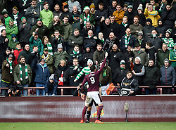 Hearts Kyle Lafferty celebrates in front of the Celtic fans after scoring his side's second goal of the game during the Ladbrokes Scottish Premiership match at Tynecastle Stadium, Edinburgh. ***Editors note gestures in crowd***