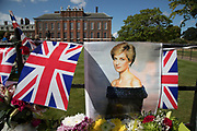 On the 20th anniversary of the death of Princess Diana, crowds of people gather to pay their respects, and to lay flowers, pictures and messages at the memorial to her on 31st August 2017 at Kensington Palace in London, United Kingdom. Diana, Princess of Wales became known as the Peoples Princess following her tragic death, and now as in 1997, thousands of royalists, and mourners came to her royal residence in remembrance.