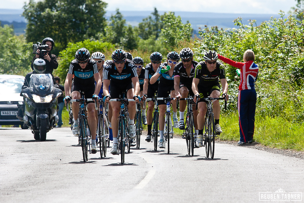 © Reuben Tabner. .Stamfordham, Northumberland, UK  26/06/11. An early break of 12 riders included six Sky riders, including, Bradley Wiggins, Geraint Thomas and Peter Kennaugh
