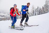 Jesse Nestler and Avery Mickey skin uphill on Buttermilk Mountain in Aspen, Colorado.