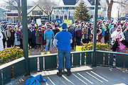Bar Harbor, Maine, USA. 19 January, 2019. Bo Greene of Indivisible MDI welcomes the crowd gathered on the Village Green for the Women's March Bar Harbor, a sister march of the national Women's March.