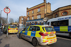 © Licensed to London News Pictures. 08/03/2021. London, UK. Police vehicles  parked on White Hart Lane after a man was found with fatal stab injuries on Penshurst Road, a second man, who is 18-years-old, was treated for stab wounds and taken to hospital. Photo credit: Peter Manning/LNP
