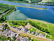 Nederland, Gelderland, Gemeente Neder-Betuwe.; 27-05-2020; Nederrijn bij Opheusden, Rijnbandijk (winterdijk). Na het hoogwater van 1995 is de dijk versterkt en verbeterd. Er zijn huizen gebouwd in het winterbed.<br /> Lower Rhine near Opheusden, Rijnbandijk (winter dyke). After the high water in 1995, the dyke was strengthened and improved. In the background nature and recreation area Maneswaard.<br /> <br /> luchtfoto (toeslag op standard tarieven);<br /> aerial photo (additional fee required)<br /> copyright © 2020 foto/photo Siebe Swart