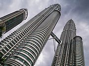 20 DECEMBER 2012 - KUALA LUMPUR, MALAYSIA:  The Petronas Tower in Kuala Lumpur, Malaysia. The Petronas Towers, also known as the Petronas Twin Towers (Malay: Menara Petronas, or Menara Berkembar Petronas) are twin skyscrapers in Kuala Lumpur, Malaysia. They were the tallest buildings in the world from 1998 to 2004 until surpassed by Taipei 101. The buildings are the landmark of Kuala Lumpur with nearby Kuala Lumpur Tower.    PHOTO BY JACK KURTZ