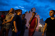 El Paso residents stand outside after a vigil ceremony at Saint Pius X Church, following a deadly mass shooting, in El Paso, Texas, Saturday, Aug. 3, 2019. (Joel Angel Juárez / AFP)
