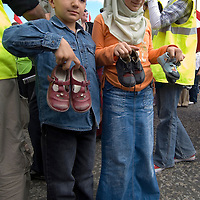 Children gathering children shoes to remember the children killed of Israeli bombardments. Protest against the war in Lebanon, Edinburgh Scotland 12 July 2006.<br />