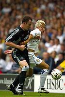Photo Aidan Ellis.<br />Leeds United v Newcastle United (FA Barclaycard Premiership) 17/08/2003.<br />Leeds Alan Smith and Newcastle's Andrew O'Brien