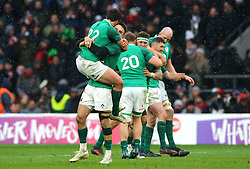 Ireland's Conor Murray and Joey Carbery celebrate winning the grand slam during the NatWest 6 Nations match at Twickenham Stadium, London.