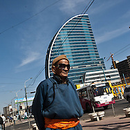 Mongolia. Ulaanbaatar. old man in traditional dress on peace avenue , the city center of  Ulaanbaatar. ,  .