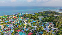 Aerial view of local island Huraa, North Malé Atoll, Maldives, Indian Ocean with mangroves and overwatervillas in the distance