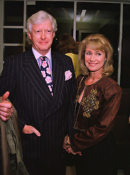 MR CHRISTOPHER RUSSELL and his wife JAN LEEMING the former newsreader, at a party in London on 27th November 1997.MDU 29