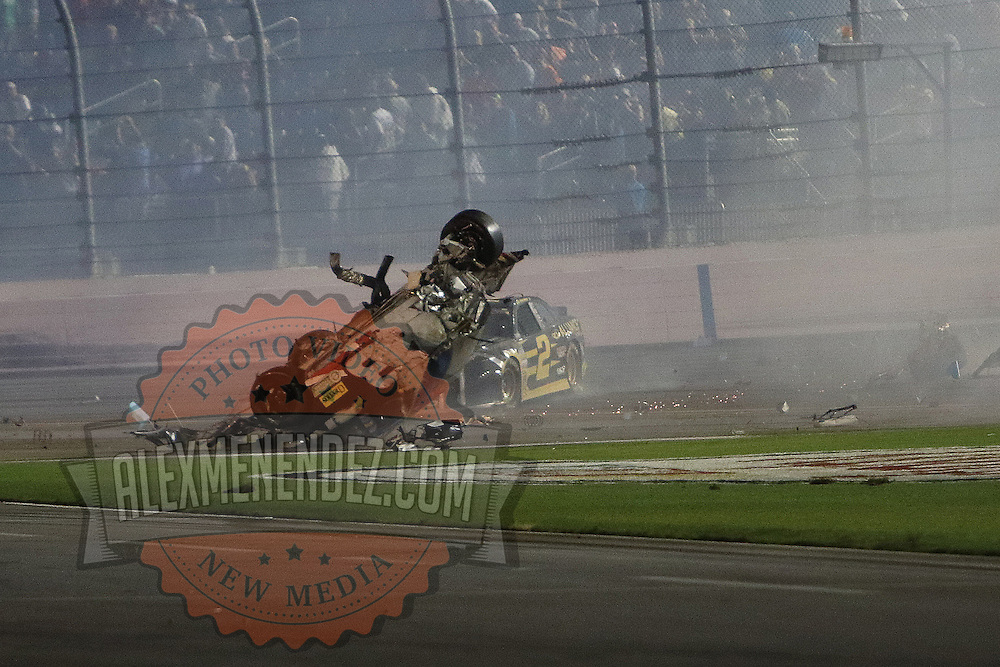 NASCAR Sprint Cup driver Brad Keselowski (2) crashes into the car of Austin Dillon (3) after he launched into the catch fence on the final lap of the 57th Annual NASCAR Coke Zero 400 stock car race at Daytona International Speedway on Monday, July 6, 2015 in Daytona Beach, Florida.  Dillon walked away from the crash. (AP Photo/Alex Menendez)