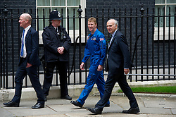 © London News Pictures. 20/05/2013 . London, UK.  Major TIM PEAKE (centre in blue), who is to become the first UK astronaut to visit the International Space Station (ISS),   with Business Secretary VINCE CABLE MP (Left) and Science minister DAVID WILLETTS  (right), arriving at 10 Downing Street in London to meet British Prime Minister David Cameron. Major Peake will become the first British astronaut in 20 years Photo credit : Ben Cawthra/LNP