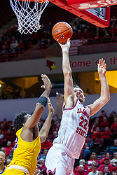 NORMAL, IL - December 07: Matt Chastain shoots a short shot while leaning left to avoid defender LJ Bryan during a college basketball game between the ISU Redbirds and the Morehead State Eagles on December 07 2019 at Redbird Arena in Normal, IL. (Photo by Alan Look)