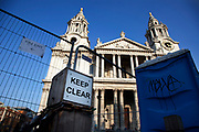 Sign saying 'Keep Clear'.Cleared Occupy London OLSX site at St Paul's Cathedral in Londo n, UK. On 27th February the Occupy anti-capitalist demonstration site was cleared and Tuesday morning was the paving stones for the first time since October 2011. The cleaned site now devoid of protesters starts to undergo a 3 day deep cleaning operation.